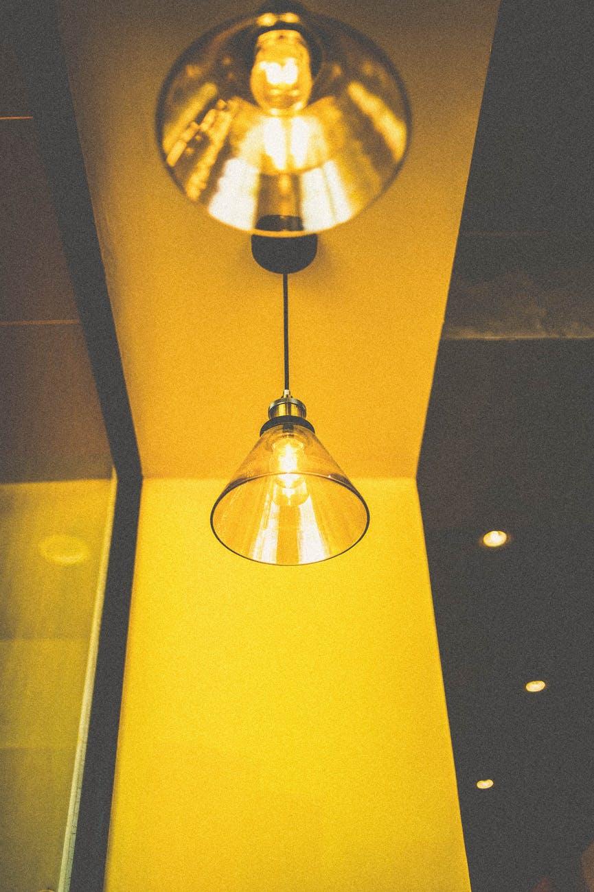 closeup photo of turned on pendant light