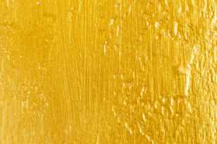 close up photo of yellow surface